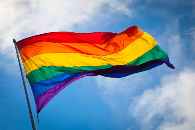 Today the flag is most widely seen with six coloured stripes -- red for life, orange for healing, yellow for sunlight, green for nature, blue for serenity, and violet for spirit