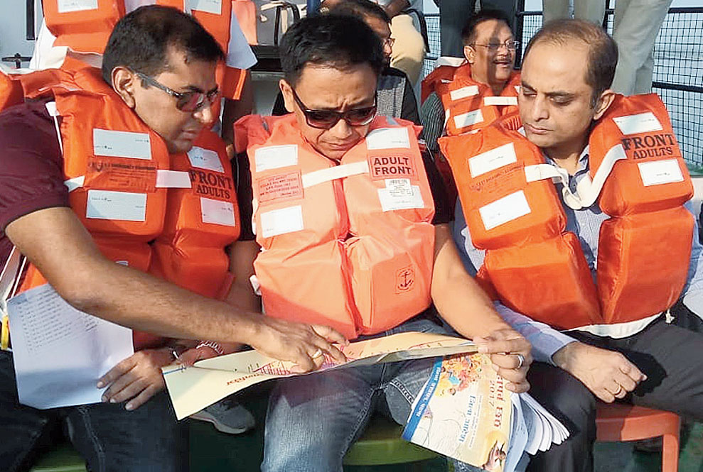 Officials inspect ghats from a steamer on Saturday.