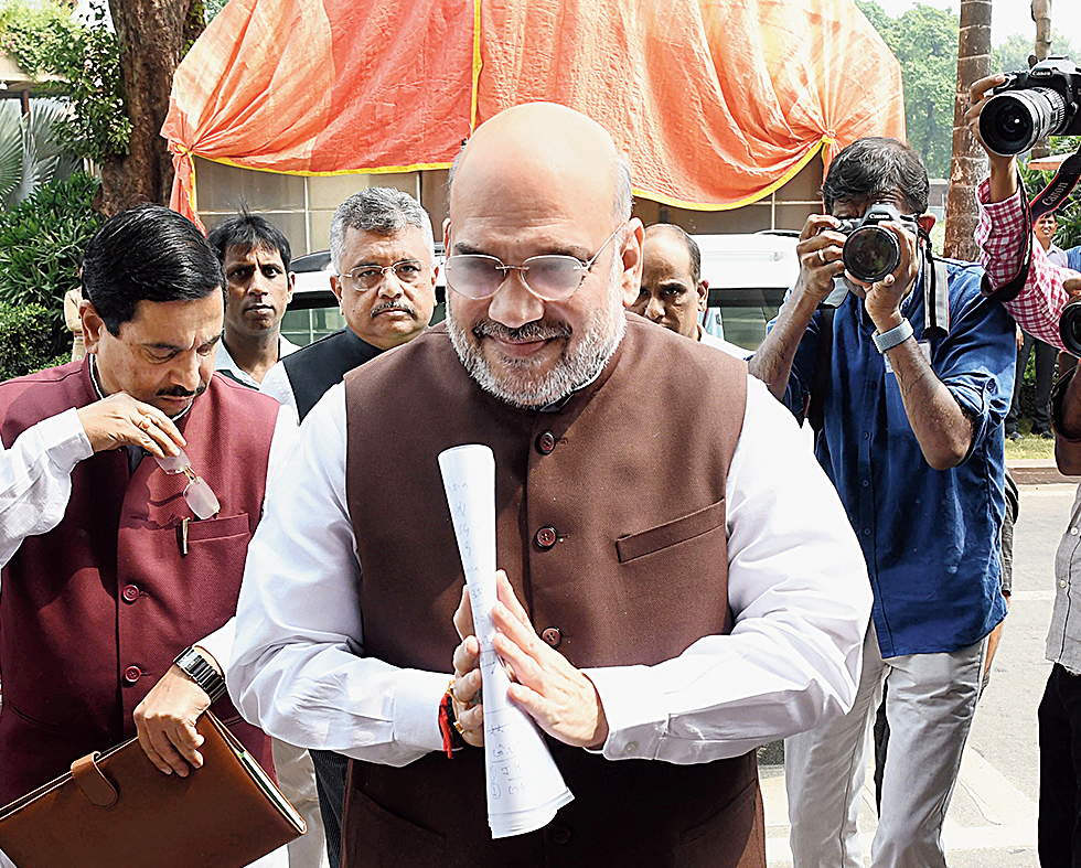 Amit Shah arrives in Parliament on Monday.