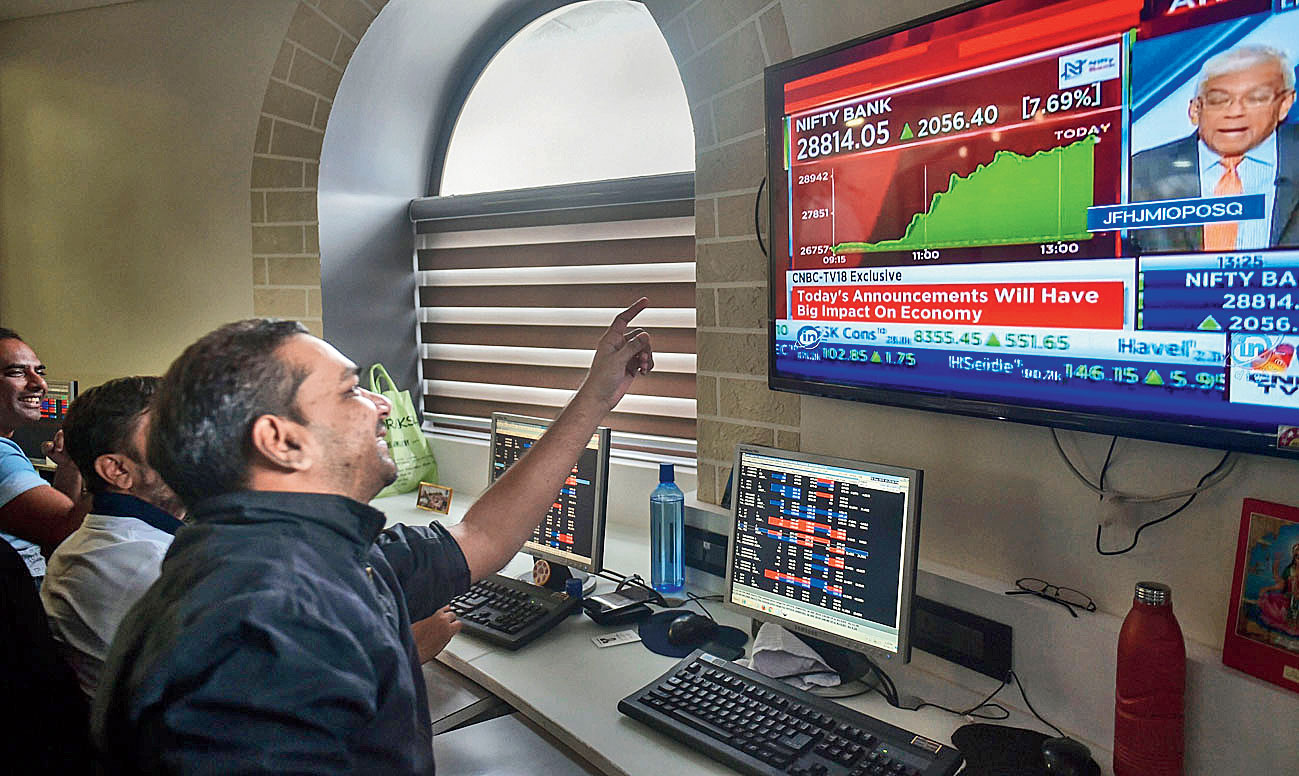 Investors at the Bombay Stock Exchange, September 20. As matters stood on that day, government policy generated hefty gains for speculators — people engaged in buying and selling paper securities as opposed to the production of goods and services.