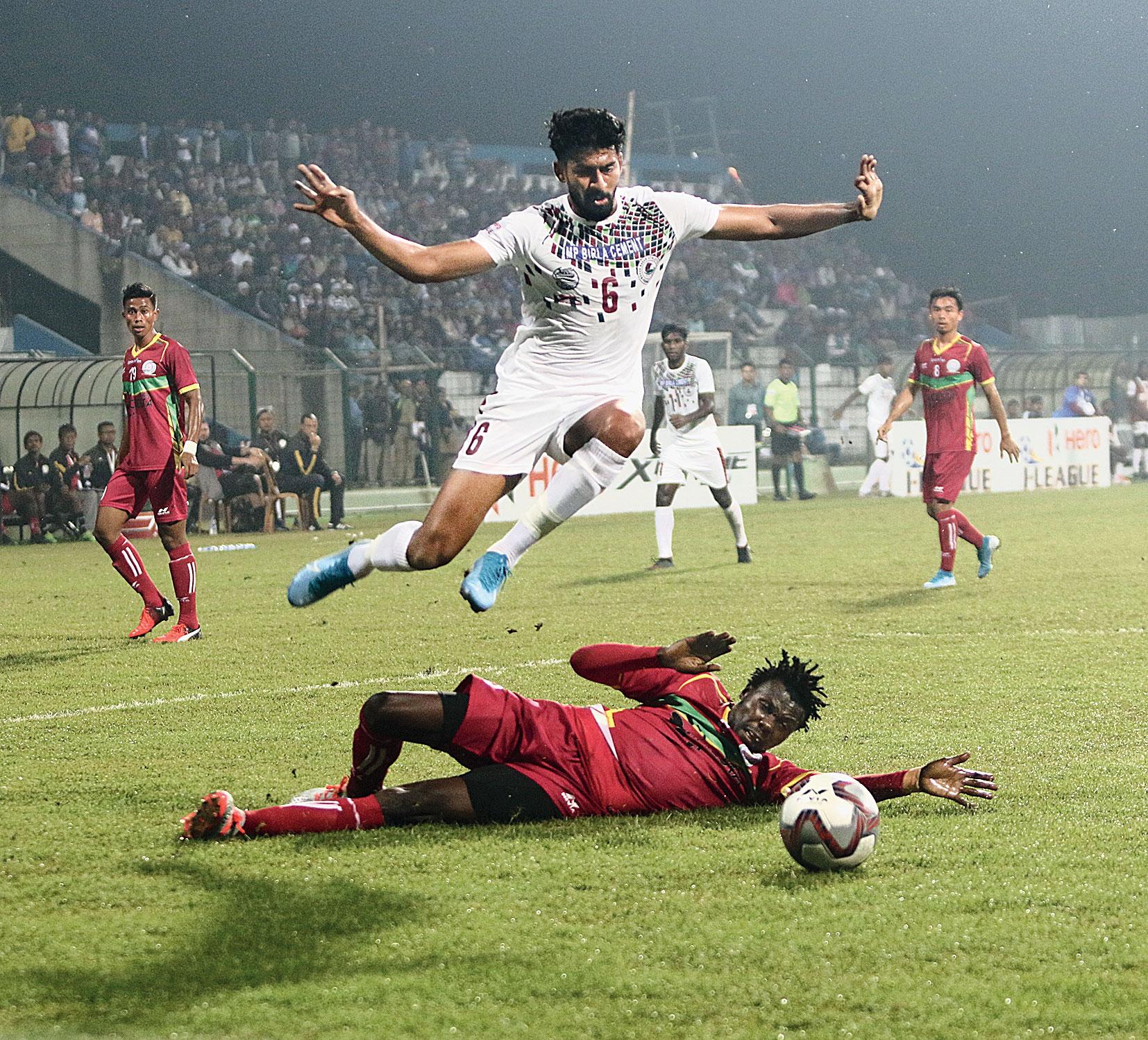 Ashutosh Mehta of Mohun Bagan evades a TRAU FC defender on Wednesday.