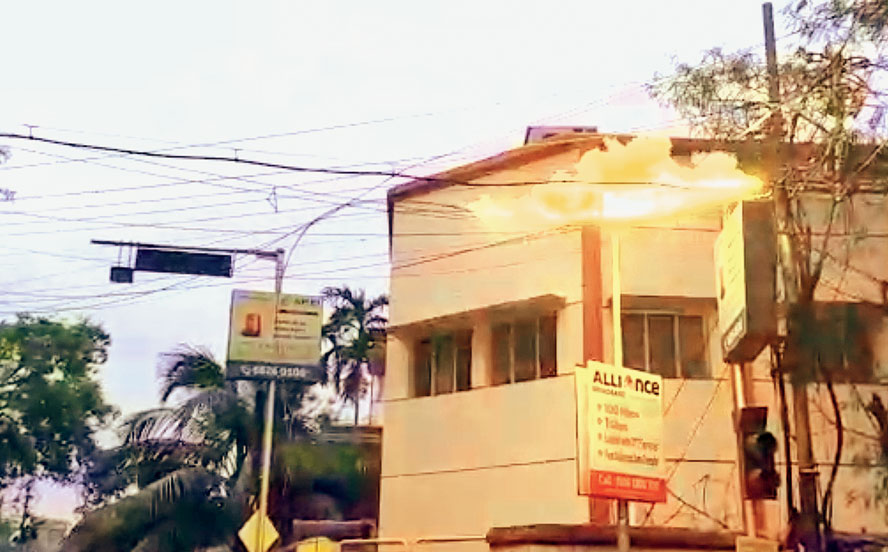 Footage show sparks lighting up and flying from overhead power lines at Suryanagar near Tollygunge on Monday evening