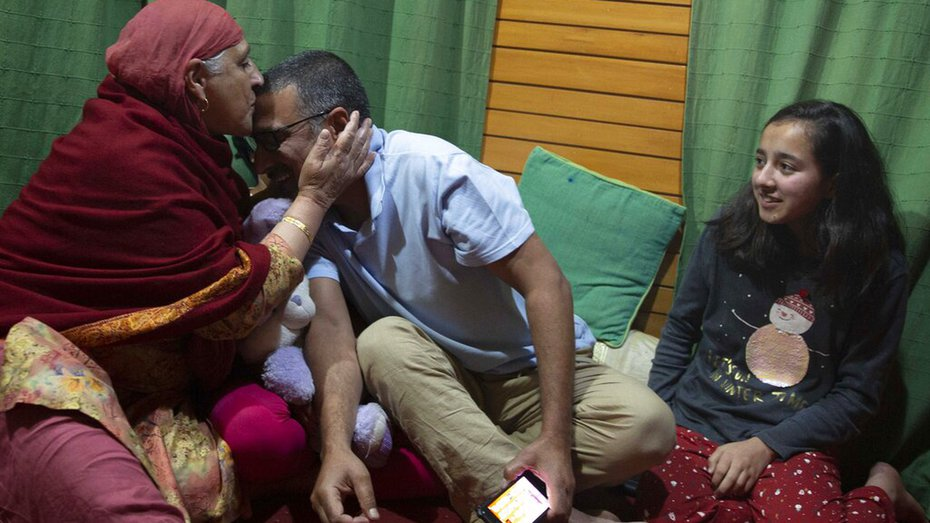 AP photographer Dar Yasin celebrates with his family at his home in Srinagar, Tuesday, May 5, 2020, following the announcement that he was one of three photographers who won the Pulitzer Prize in Feature Photography for their coverage of the Kashmir conflict.