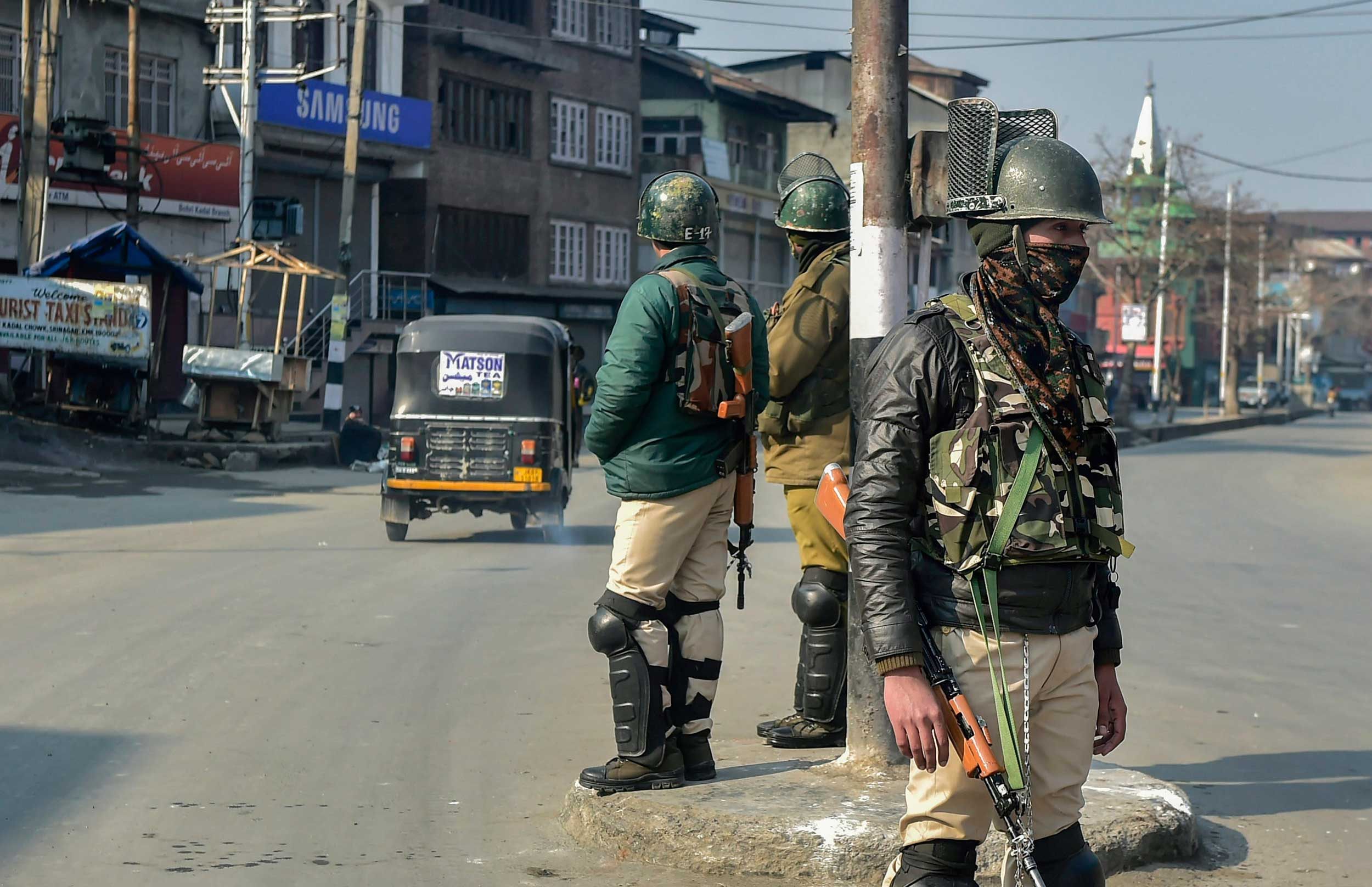 CRPF personnel stand guard during restrictions imposed to thwart any possible protest in Srinagar on Sunday.