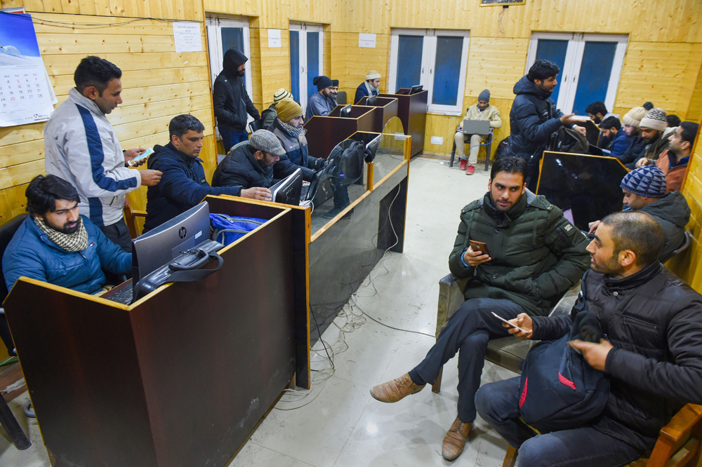 Journalists at a media facilitation centre in Srinagar on Friday