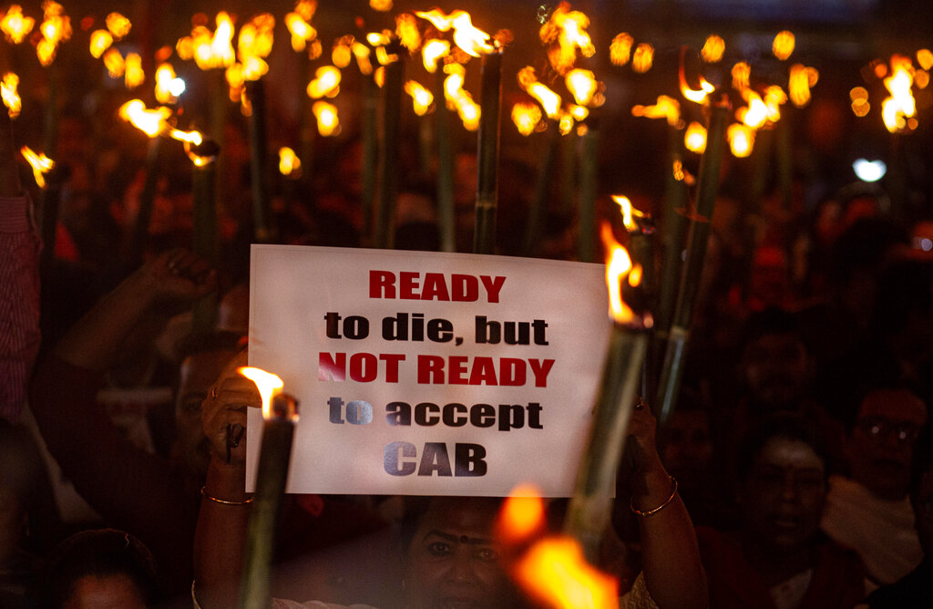 People participate in a torch light procession to protest against the Citizenship Amendment Bill (CAB) in Gauhati, on Saturday, Dec. 7, 2019.