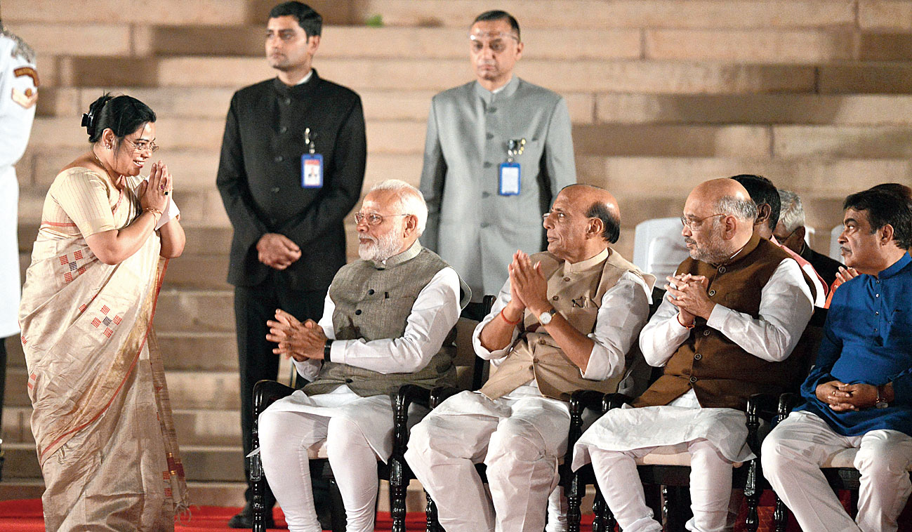 Debasree Chaudhuri greets Modi and other BJP leaders after taking oath in New Delhi.