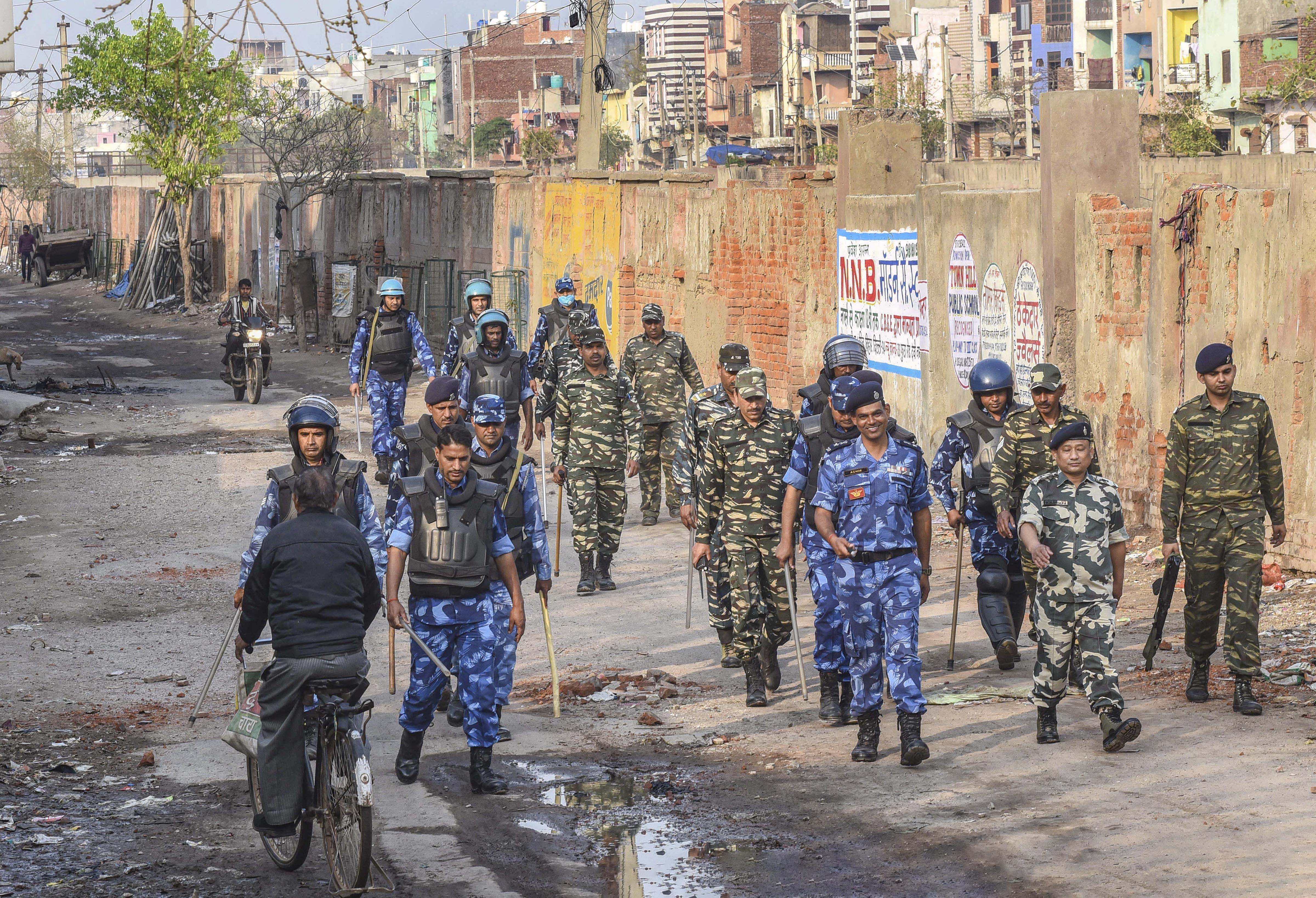 Security personnel patrol a violence-affected area of North East Delhi on Sunday.