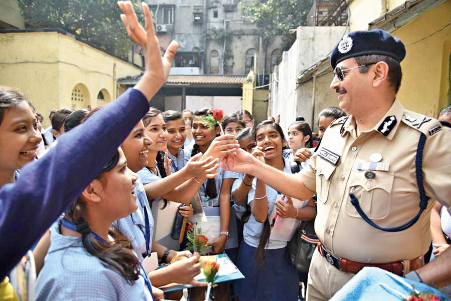 Calcutta police commissioner Anuj Sharma interacts with Madhyamik examinees in front of a city school on Tuesday.