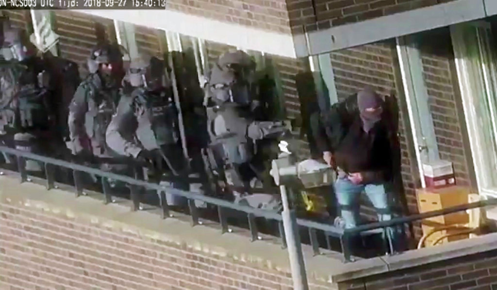 Armed police prepare for an operation in a residential area in Arnhem, Netherlands, on Thursday.