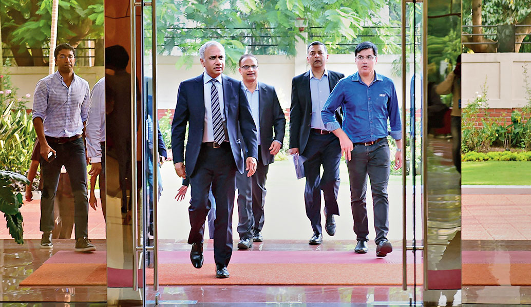 Infosys CEO Salil Parekh (left), chief operating officer Pravin Rao (behind) and CFO Nilanjan Roy (second from right) in Bangalore.