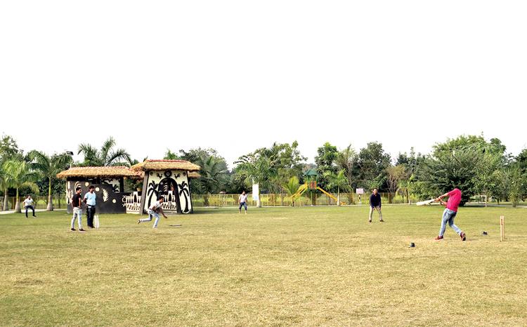 A game of cricket under way at Eco Urban Village
