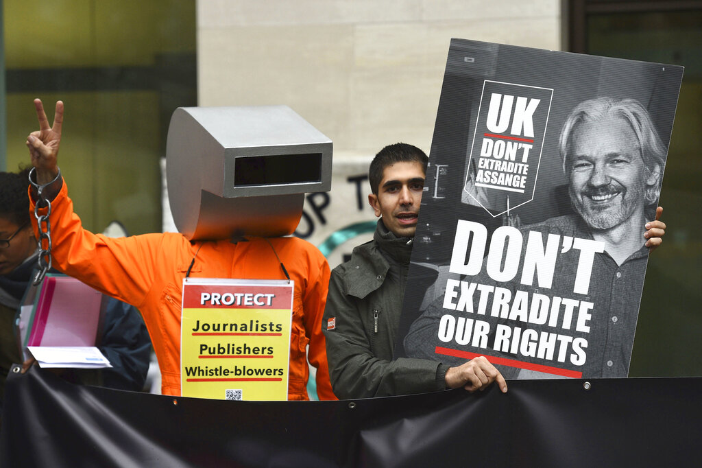 Supporters of Wikileaks founder Julian Assange demonstrate oustide Westminster Magistrates' Court in London, Monday, October, 21, 2019.