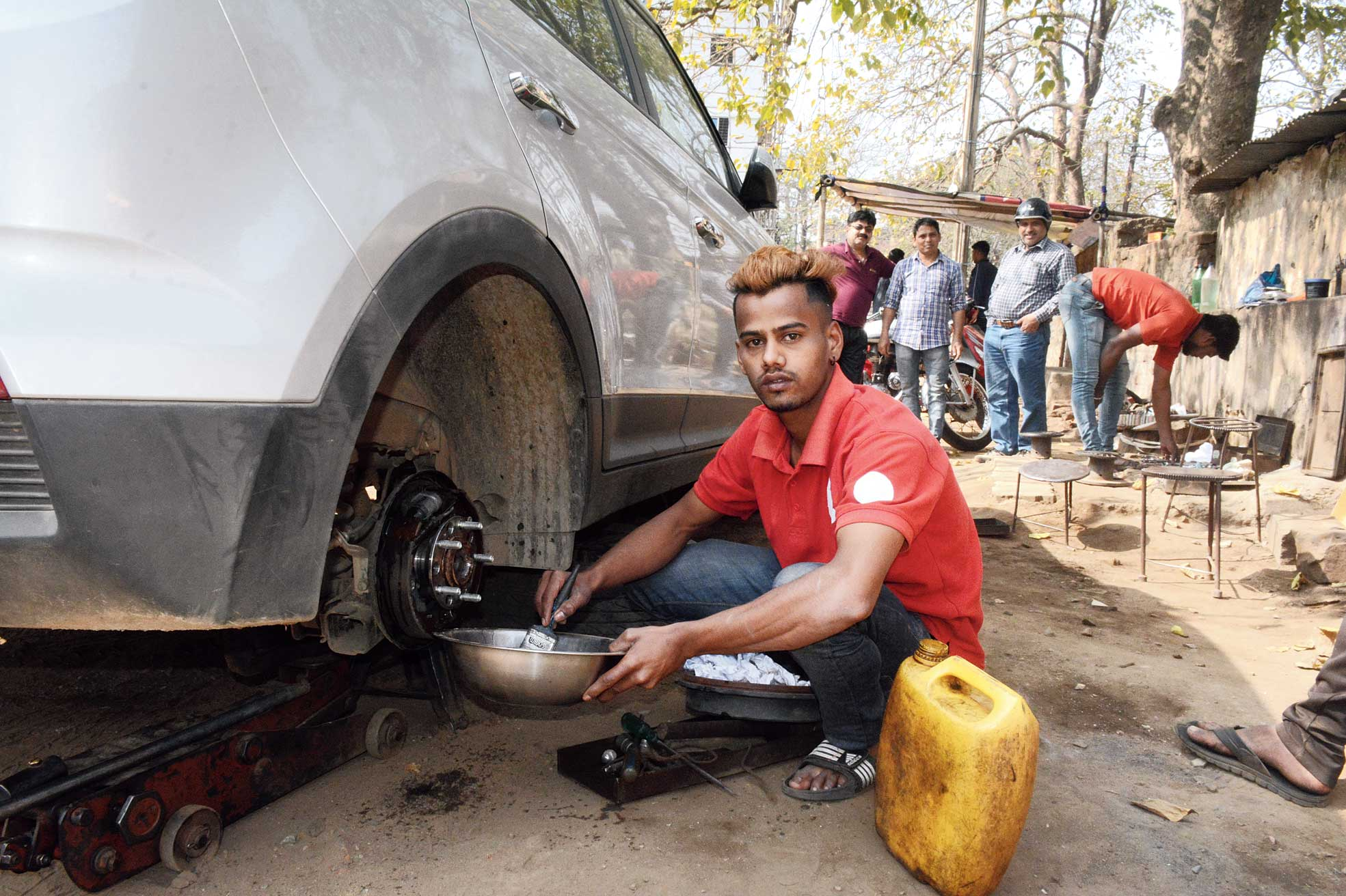 Talim Ansari works at a garage in Dhatkidih, Jamshedpur.