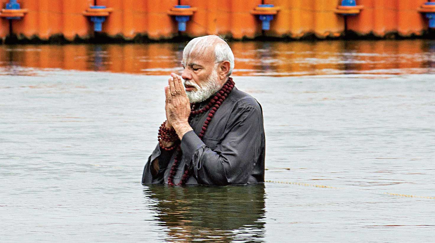 Prime Minister Narendra Modi takes a holy dip at the Sangam during the Ardh Kumbh Mela in Allahabad on Sunday. Modi later washed the feet of five persons employed as sweepers by the Allahabad municipality and said the moment would remain with him.