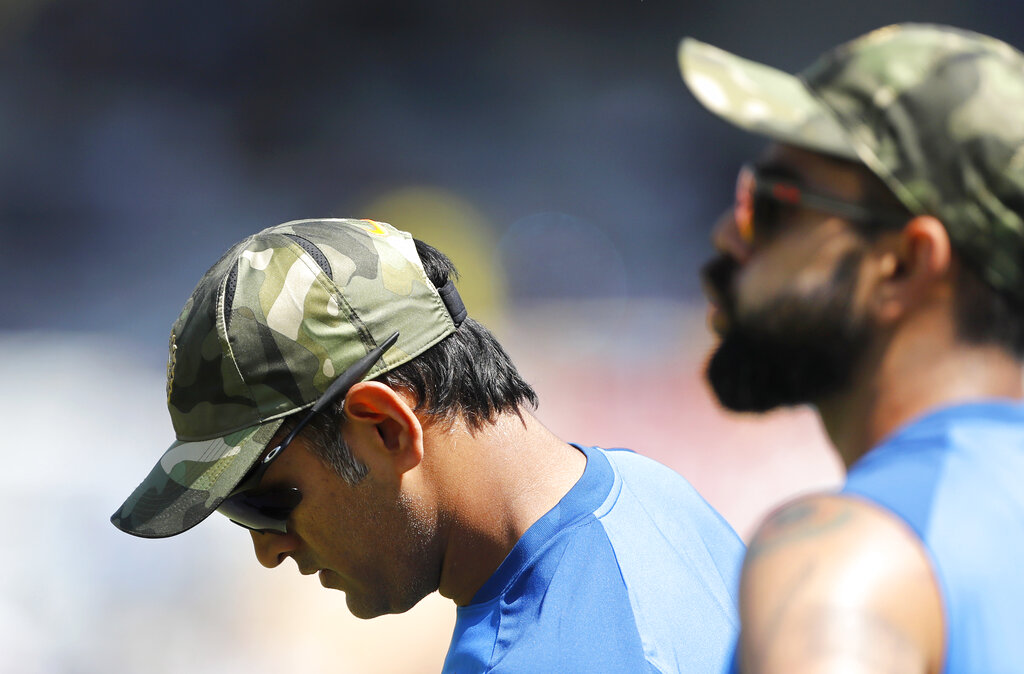 Virat Kohli (right) and Mahendra Singh Dhoni sport camouflage caps before the start of the third ODI between India and Australia in Ranchi on Friday.