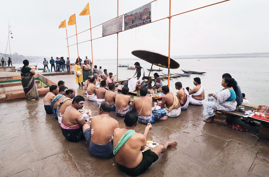 Rituals being performed on the bank of the Ganga in Varanasi on December 14.