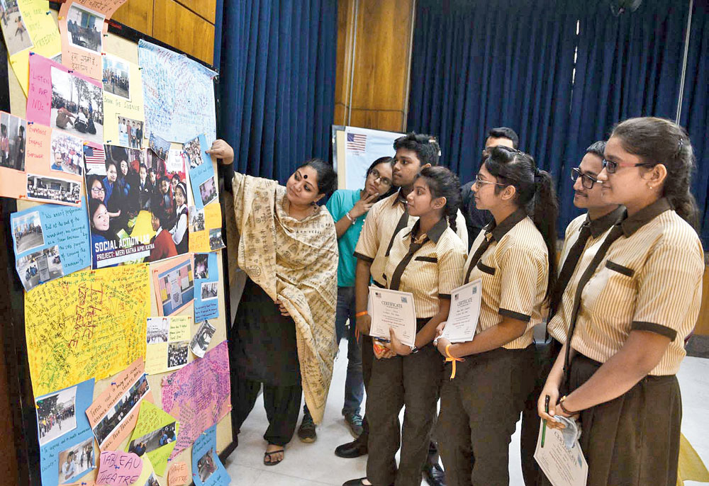 Antara Roychowdhury with students of Behala High School at the American Center on Friday
