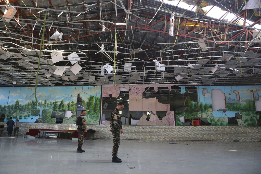 Afghan soldiers inspect a damaged Dubai City wedding hall after an explosion in Kabul on Sunday, August 18, 2019. A suicide-bomb blast ripped through a wedding party on a busy Saturday night