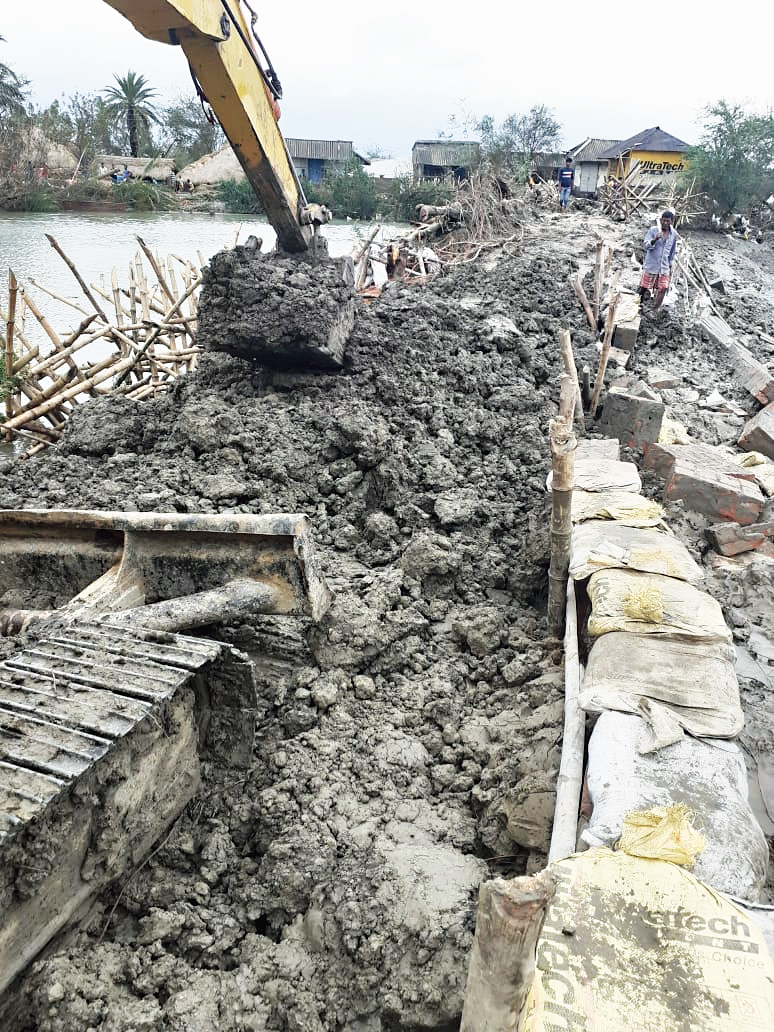Repairs of a breached embankment by the state irrigation department at Gosaba in South 24-Parganas