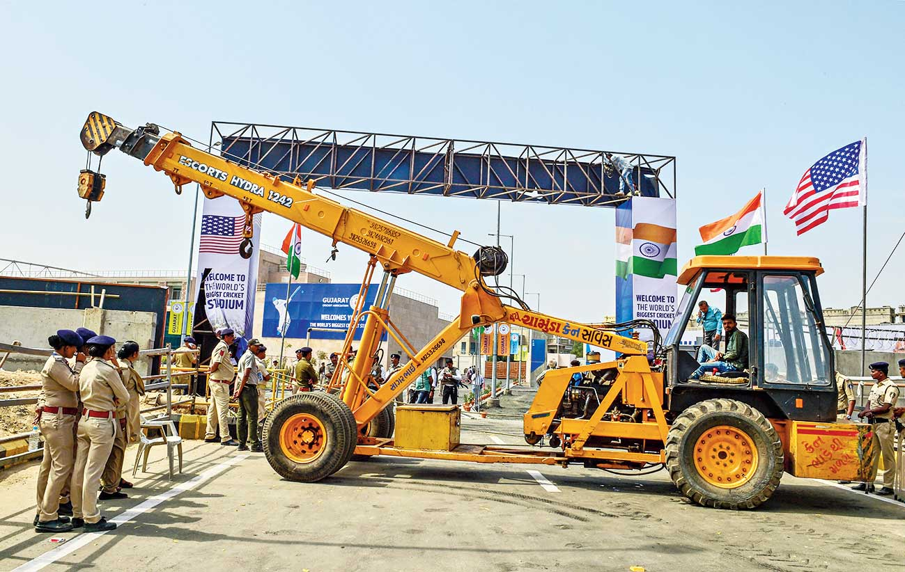 Workers use a crane to re-install a temporary gate at Motera Stadium, Ahmedabad, after it collapsed on Sunday.