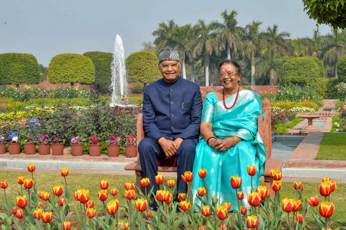 President Ram Nath Kovind with his wife Savita poses for photographs during the opening of annual Udyanotsav (Festival of Gardens), at Mughal Garden of Rashtrapati Bhawan in New Delhi, on Tuesday