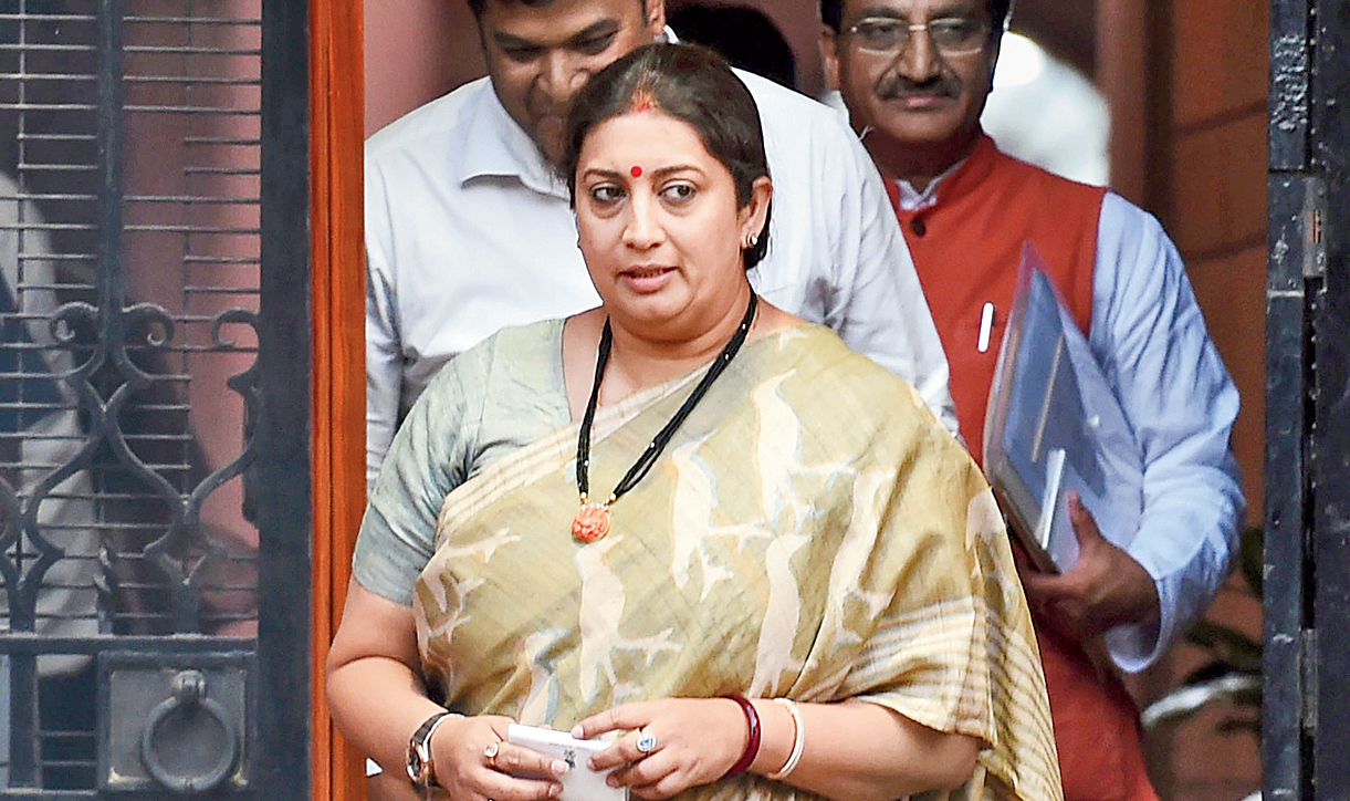 Smriti Irani leaves after the cabinet meeting in New Delhi on Friday.