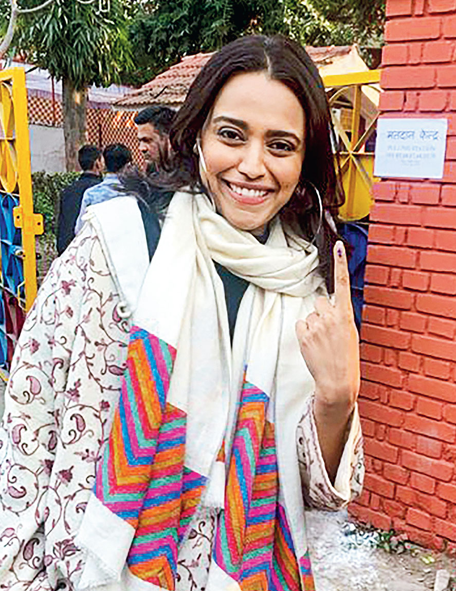 Actress Swara Bhaskar shows her inked finger.