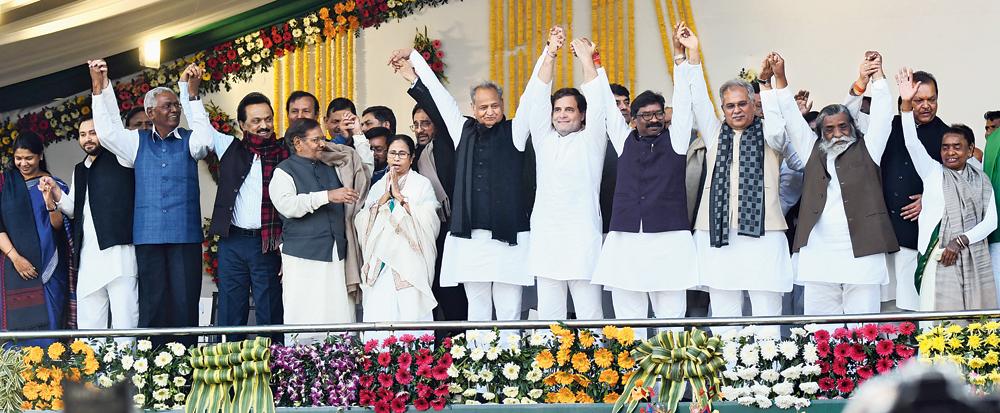 (From left) M Kanimozhi, Tejashwi Yadav, D Raja, MK Stalin, Sharad Yadav,  Mamata Banerjee,  Atul Kumar Anjan, Ashok Gehlot, Rahul Gandhi, Hemant Soren, Bhupesh Baghel, and Hemant's parents Shibu and Rupi Soren during the swearing-in ceremony at Morabadi ground in Ranchi