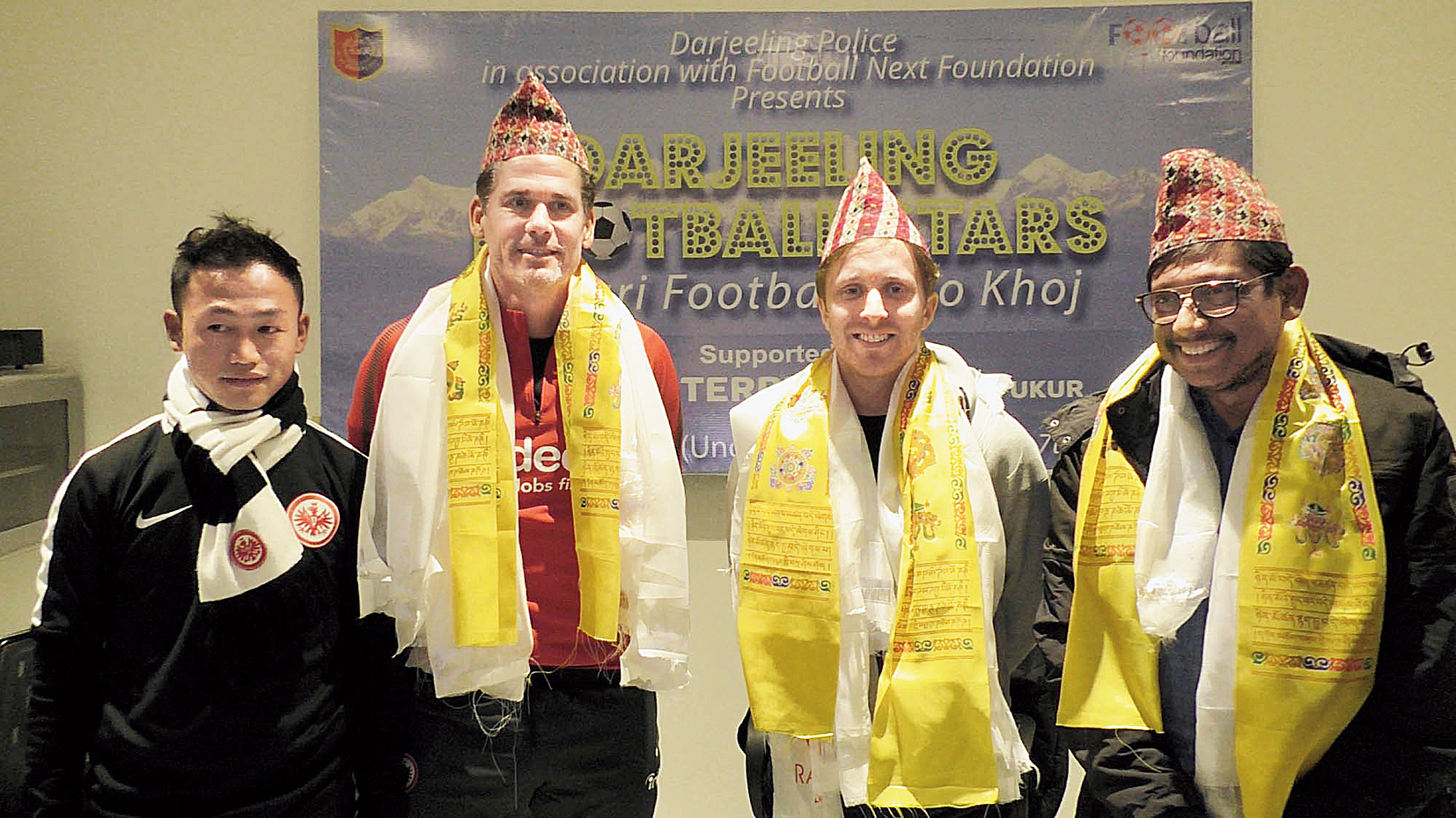 (From left) Player Manish Subba with Eintracht Frankfurt officials, Nicolai Adam and Felix Hansvencl, and Kaushik Moulik in Darjeeling on Thursday