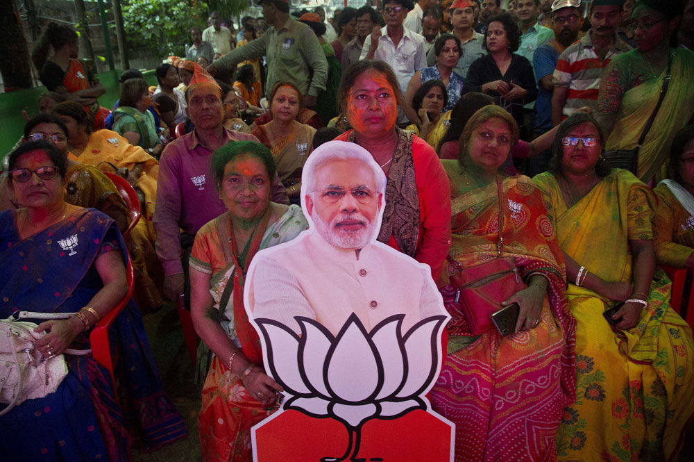 BJP supporters celebrate at their party office in Guwahati on Thursday, May 23, 2019.