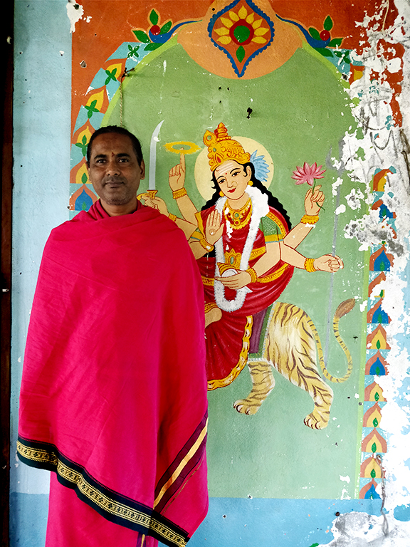Balaram, the presiding priest at the Mahakali temple, speaks French at home