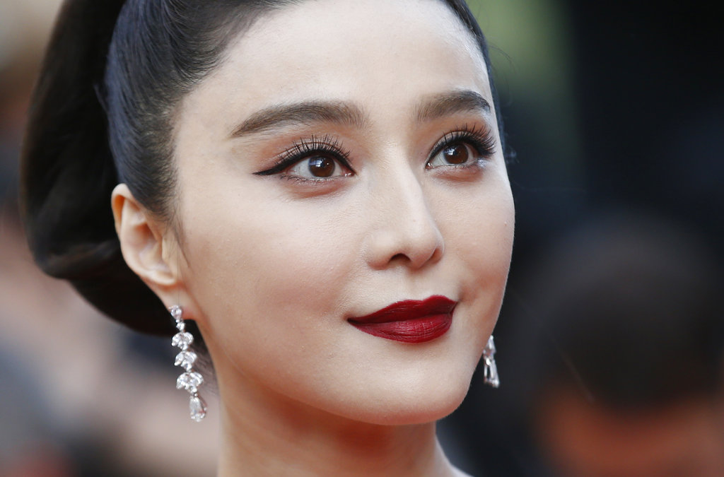 In this May 24, 2017, file photo, Fan Bingbing poses for photographers as she arrives for the screening of the film The Beguiled at the 70th international film festival, Cannes, southern France
