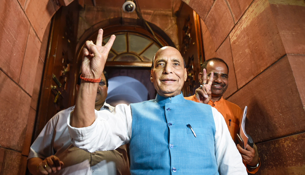 Union Defence Minister Rajnath Singh flashes the victory sign, at Parliament in New Delhi, Tuesday, August 6, 2019. The Lok Sabha approved the abrogation of special status given to Jammu and Kashmir under Article 370 on Tuesday.