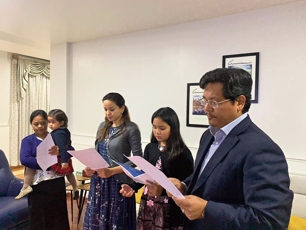Chief minister Conrad K. Sangma and his family pray in Shillong on Sunday