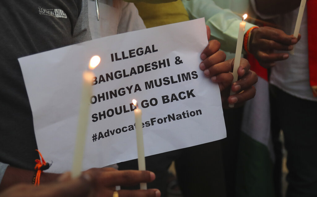 Activists of Hindu Sangathan participate in a candle light protest to paying tribute Indian security officers who were killed during communal violence in New Delhi, in Hyderabad, on Saturday