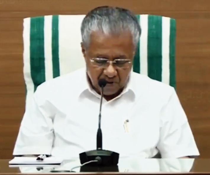 Vijayan at a media briefing