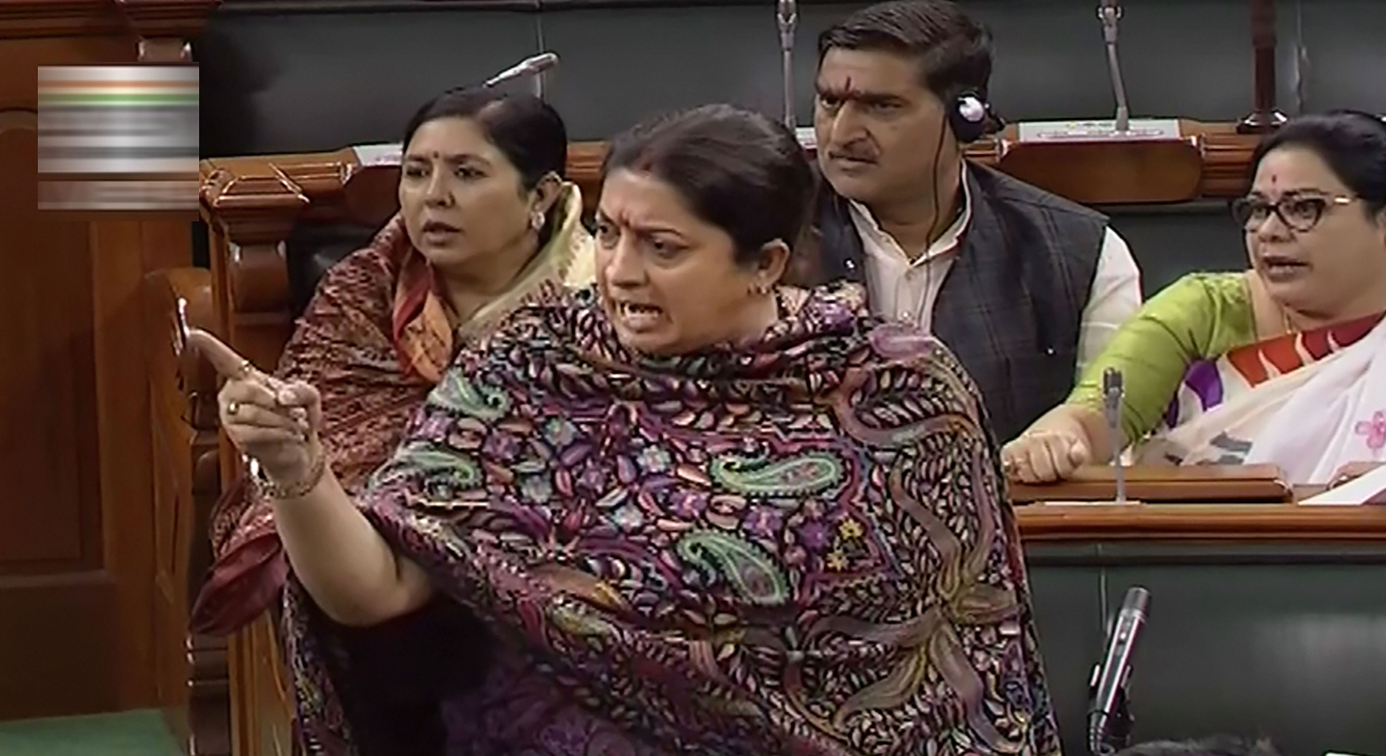 Union woman and child welfare minister Smriti Irani speaks in the Lok Sabha during the winter session of Parliament, in New Delhi, Friday, December 6, 2019.