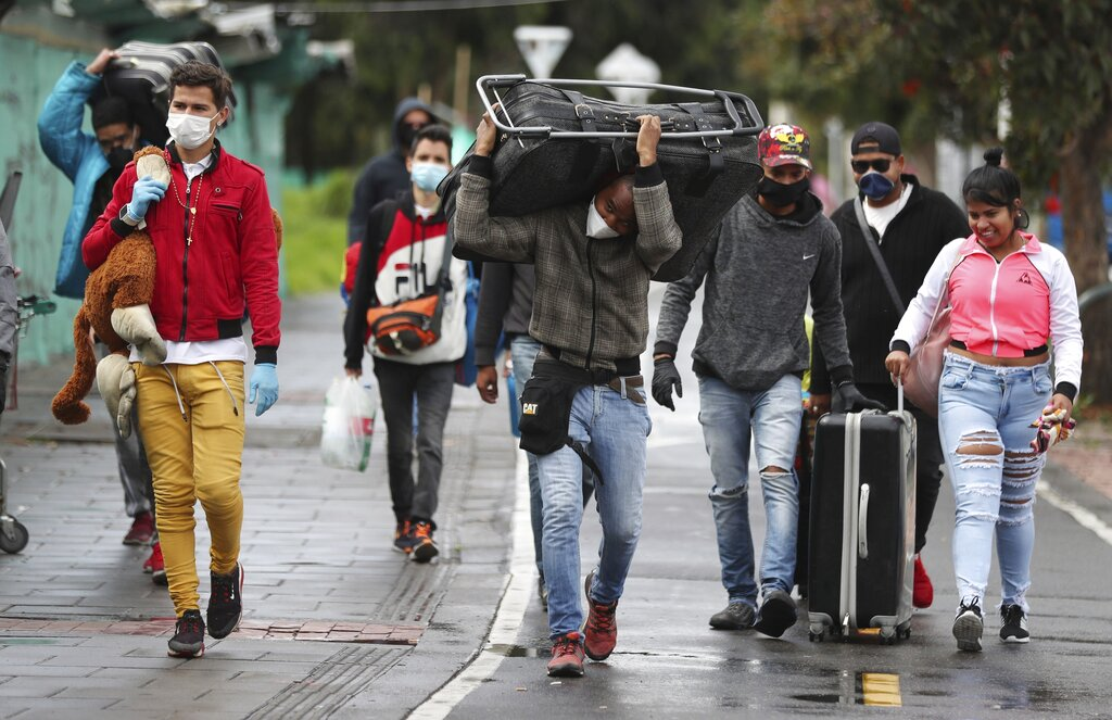 Venezuelan migrants leave on foot toward the Venezuelan border, with the aim of leaving Colombia after a lockdown ordered by the government in an effort to prevent the spread of the new coronavirus, in Bogota, Colombia, Monday, April 6, 2020.