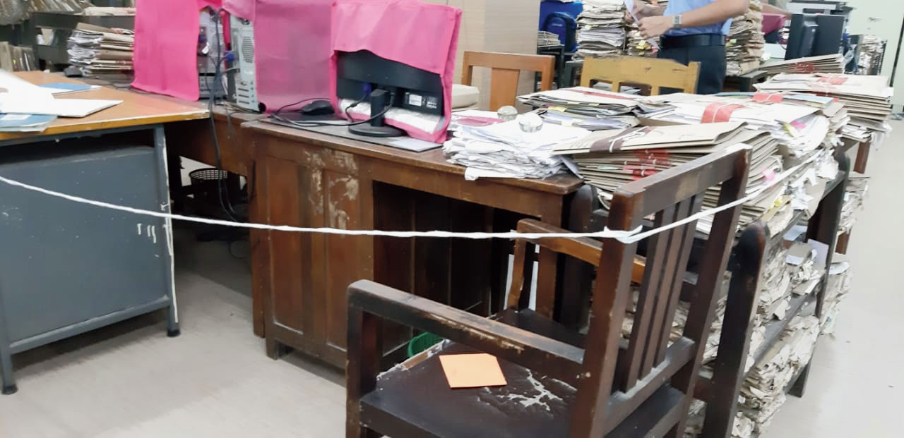 A chair cordoned off to avoid anyone sitting at the adjacent table at Bikash Bhavan.