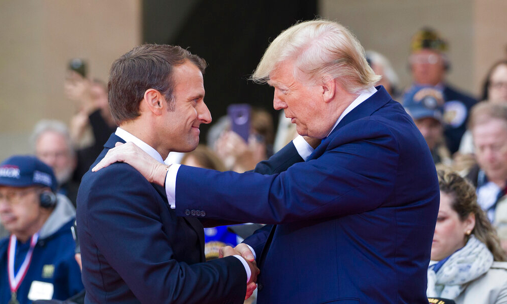 French President Emmanuel Macron and American President Donald Trump speak during a ceremony to commemorate the 75th anniversary of D-Day at the American Normandy cemetery, Thursday, June 6, 2019, in Colleville-sur-Mer, Normandy, France.
