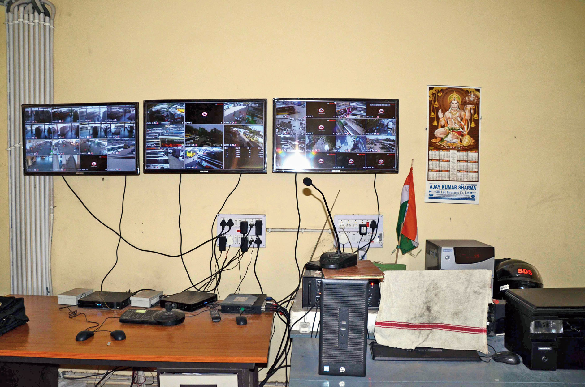 The screens monitoring the CCTV cameras in the building show an alarming number of black rectangles signifying defunct devices.