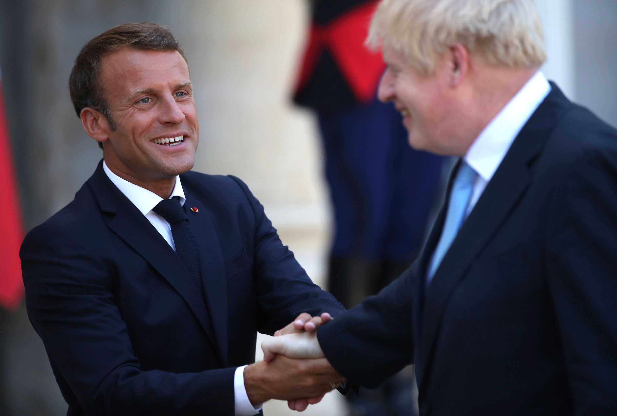 French President Emmanuel Macron bids farewell to Britain's Prime Minister Boris Johnson at the Elysee Palace in Paris on August 22, 2019.