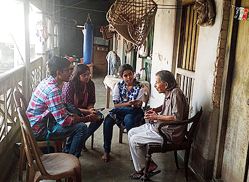 Students talk to custodians of heritage structures in Chandernagore and (top) photograph one such building