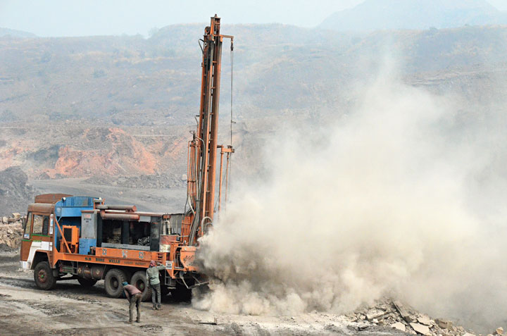 Dust rises during a drilling process at a BCCL open cast mine in Jharia on Tuesday.