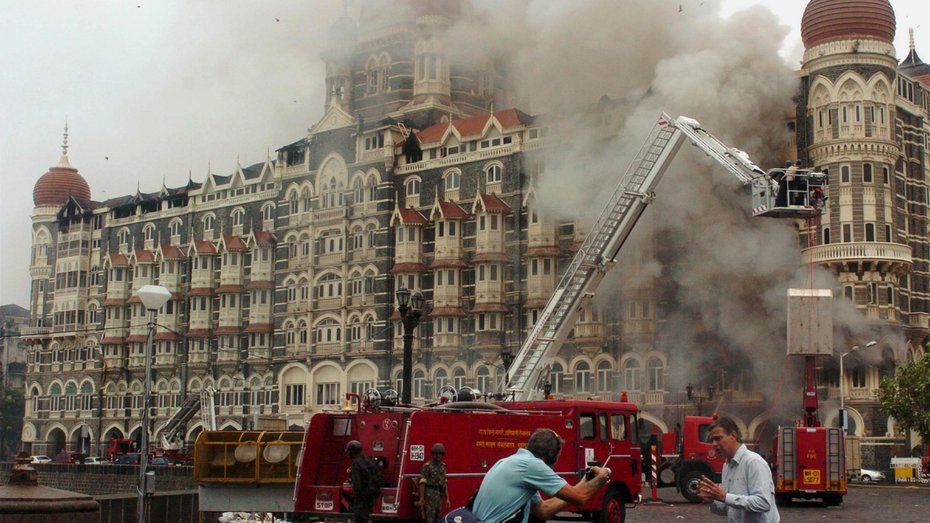 Fire brigade personnel work at the Taj Mahal Hotel in Mumbai on November 29, 2008, after terrorists attacked the hotel and other locations in the city