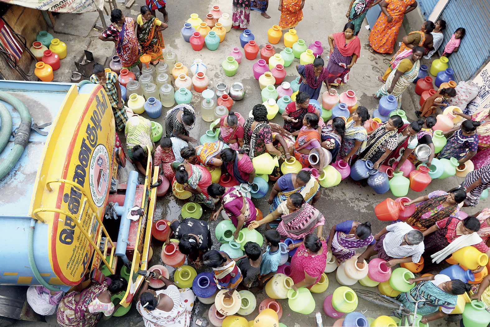 Residents could be seen crowded around water tankers in temperatures of over 40°C, holding buckets as media reported scuffles