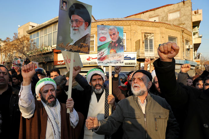 Iranian protesters in front of the British embassy in Tehran on Sunday