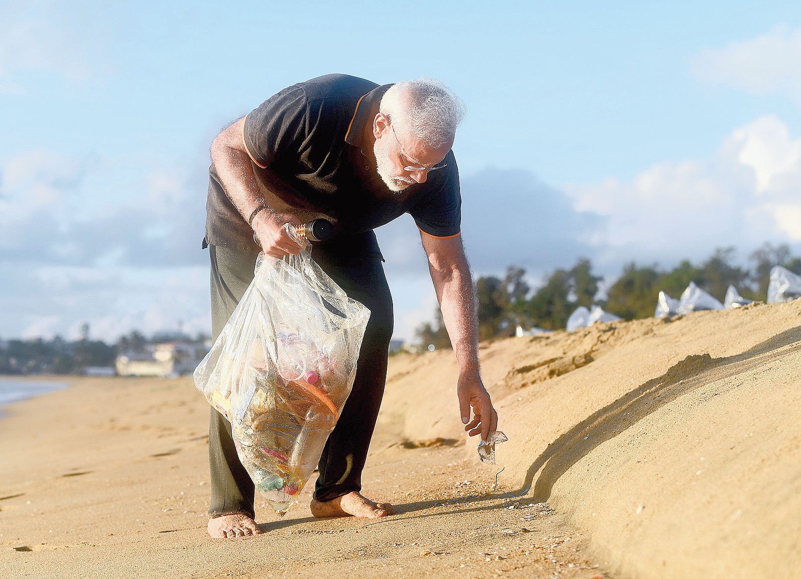 Prime Minister Narendra Modi plogs along the scenic coast of Mahabalipuram on Saturday.