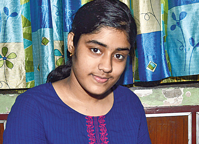 CBSE city topper and all India fourth ranker Suchana Halder displays her foreign currency collection at her Elite Cooperative Housing home in Ultadanga.